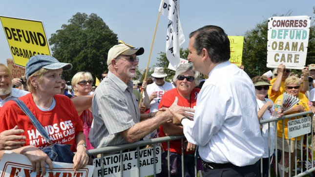 Sen. Ted Cruz (R-TX) greets demonstrators in front of the US Capitol at a Tea Party rally to push for de-funding Obamacare, The Affordable Care Act, on Capitol Hill, September 10, 2013, in Washington, DC. Unable to override votes to defeat President Barack Obama's health care act, some Congressional Republicans are hoping to end funding for it. UPI/Mike Theiler