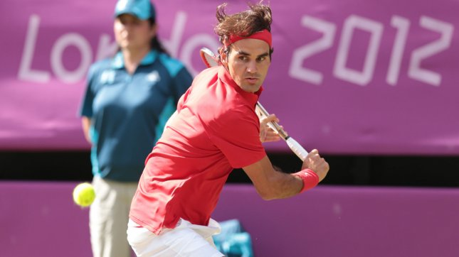 Switzerland's Roger Federer in action at the London 2012 Summer Olympics on August 02, 2012 in Wimbledon, London. He beat Juan Martin del Potro of Argentina 3-6, 7-6 (7-5), 19-17 on Centre Court. The match lasted 4 hours, 25 minutes. UPI Fil Photo/Hugo Philpott