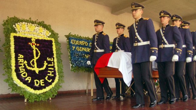 The coffin of Gen. Augusto Pinochet is carried by Honor Guard soldiers to a mass during his funeral at the Military Academy in Santiago on December 12, 2006. 40 years after the military coup that put Pinochet in power, the country is still divided on how to commemorate the fall of Allende and subsequent human rights violations under Pinochet and the junta. (UPI Photo/Cristobal Arjona)