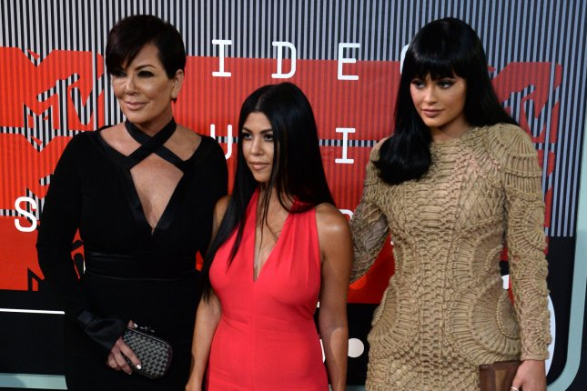 Kris Jenner (L) with daughters Kourtney Kardashian and Kylie Jenner (R) at the MTV Video Music Awards on Aug. 30. File photo by Jim Ruymen/UPI