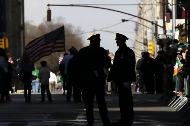 Two of the four NYPD officers charged in the corruption investigation are accused of expediting the processing of pistol permits for members of the Jewish community in Borough Park, Brooklyn, in exchange for thousands of dollars in cash. Photo by John Angelillo/UPI