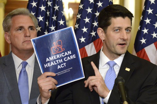 House Speaker Paul Ryan (R) holds a copy of the new healthcare bill introduced by Republicans, as Majority Leader Kevin McCarthy of California looks on, on Capitol Hill, March 7. On Wednesday, the nonpartisan Congressional Budget Office released its analysis of the bill, which it said would leave 23 million people uninsured over the next decade. File Photo by Mike Theiler/UPI