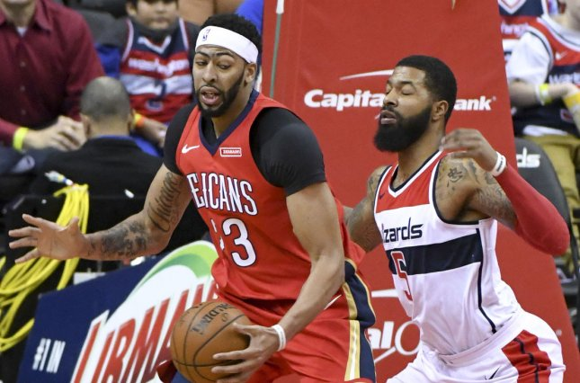 f29199b15 New Orleans Pelicans forward Anthony Davis (23) works the ball to the  basket in the first half against Washington Wizards forward Markieff Morris  (5) on ...