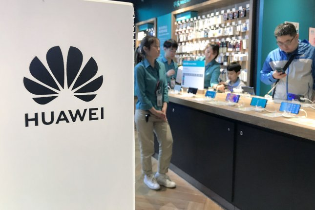 Customers shop Monday at a Huawei store in Beijing, China.Photo by Stephen Shaver/UPI