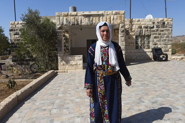 Muftia Tlaib, the grandmother of U.S. Rep. Rashida Tlaib walks outside the family's home in the West Bank village of Beit Ur Al-Fauqa on Friday.  Photo by Debbie Hill/UPI