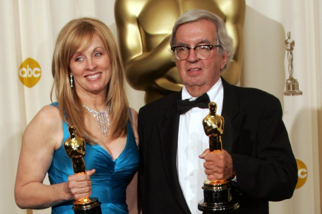Writers Larry McMurtry (R) and Diana Ossana pose with their Oscars for Brokeback Mountain at the 78th Annual Academy Awards on March 2006. McMurtry has died at the age of 84. File Photo by Gary C. Caskey/UPI