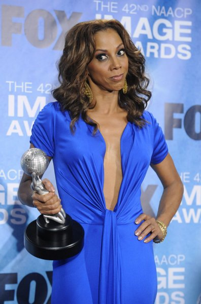 Holly Robinson Peete poses backstage with her award at the 42nd NAACP Image Awards Awards held at the Shrine Auditorium in Los Angeles on March 4, 2011. UPI/Phil McCarten