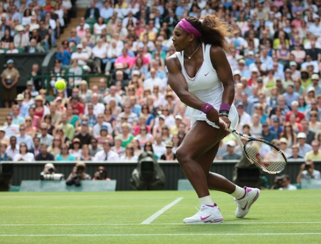 Serena Williams, shown at last year's Wimbledon Championships, dropped just four games Tuesday in opening her 2013 Wimbledon with a first-round win. UPI/Hugo Philpott