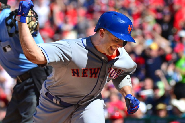 New York Mets third baseman David Wright celebrates after scoring off of a Yoenis Cespedes double in the seventh inning against the Washington Nationals at Nationals Park in Washington, D.C. on September 7, 2015. Photo by Kevin Dietsch/UPI