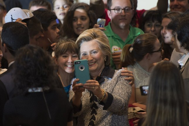 Democratic presidential candidate Hillary Clinton takes a selfie with a supporter during a campaign rally in Pittsburgh on June 14. Clinton proposed bringing broadband Internet access to all Americans by 2020 as part of her technology plan, released Tuesday. Photo by Kevin Dietsch/UPI