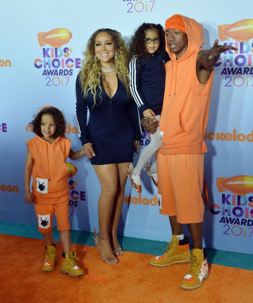 TV personality Nick Cannon and singer Mariah Carey and their twin children Moroccan (L) and Monroe attend Nickelodeon's Kids' Choice Awards at USC's Galen Center in Los Angeles on Saturday. Photo by Jim Ruymen/UPI