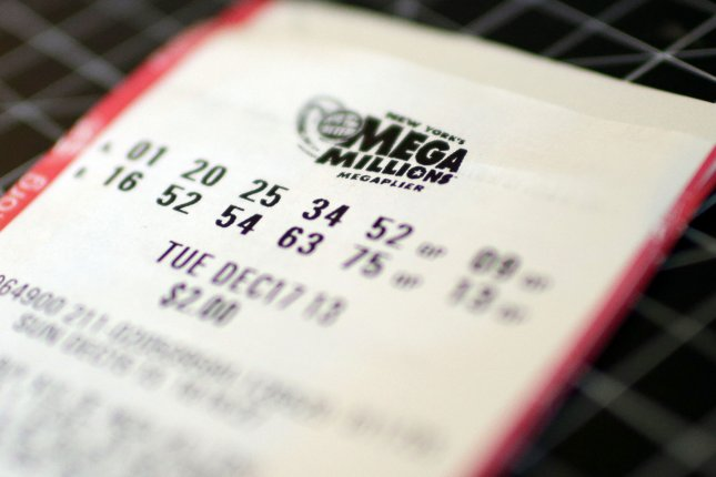 A Kansas Lottery player said gas station workers tracked him down after his brother dropped a $1 million winning Mega Millions ticket at the store. File Photo by John Angelillo/UPI