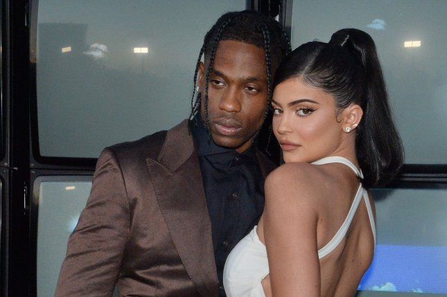 Kylie Jenner (R), pictured with Travis Scott, sold a majority stake in Kylie Cosmetics. File Photo by Jim Ruymen/UPI
