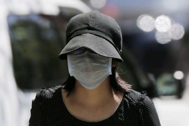Most people with chronic lung diseases can safely wear a mask, according to experts. Pictured, a woman wears a protective face mask while climbing stairs on the Upper West Side of Manhattan during the COVID-19 Pandemic in New York City in May. Photo by John Angelillo/UPI
