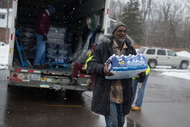 Volunteers deliver bottled water to residents in Flint, Mich., on March 5, 2016. Flint residents were asked to use bottled water after the city's drinking water was found to be contaminated with lead after the water source was switched from Detroit Water and Sewerage Dept. to the Flint River in April 2014. File Photo by Molly Riley/UPI