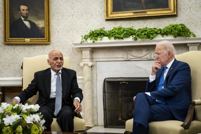 U.S. President Joe Biden listens as Afghanistan President Ashraf Ghani speaks during a meeting in the Oval Office at the White House in Washington, D.C., last Friday, amid the ongoing retrograde of the U.S. military from Afghanistan. Pool Photo by Pete Marovich/UPI