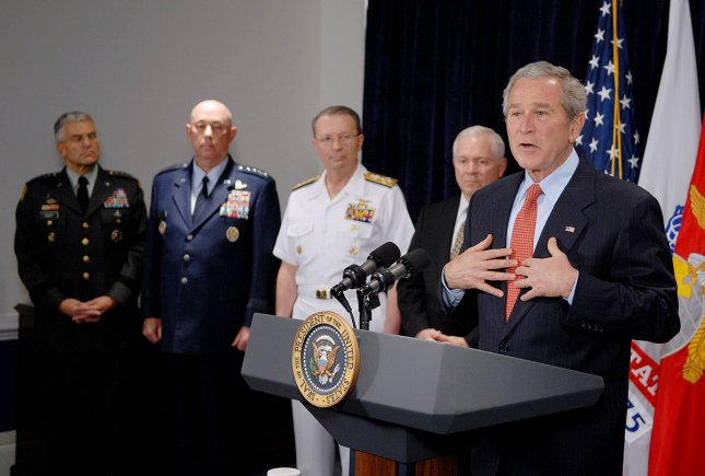 U.S. Gen. Michael Moseley (second from left) was forced to resign Thursday along with Air Force Secretary Michael Wynne were forced out because they couldn't implement changes Defense Secretary Robert Gates. (File photo of appearance with President George W. Bush (far right), Gen.George Casey (far left), Adm. Edmund Giambastiani (C), Secretary of Defense Robert Gates (second from right) May 10 2007.) Pool photo by Polaris.