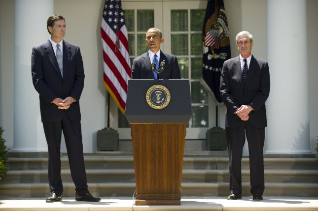 President Barack Obama delivers remarks alongside Robert Mueller (R), outgoing FBI director, and James Comey, his nominee to replace Muller, during a ceremony in the Rose Garden at the White House on June 21, 2013. UPI/Kevin Dietsch