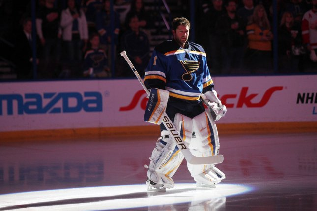 St. Louis Blues goaltender Brian Elliott stands for the National Anthem before a game against the Carl Detroit Red Wings at the Scottrade Center in St. Louis on January 15, 2015. Photo by Bill Greenblatt/UPI