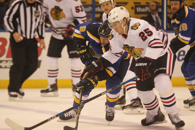 Chicago Blackhawks Dale Weise and St. Louis Blues Steve Ott tie up in the first period at the Scottrade Center in St. Louis on April 21, 2016. Photo by Bill Greenblatt/UPI