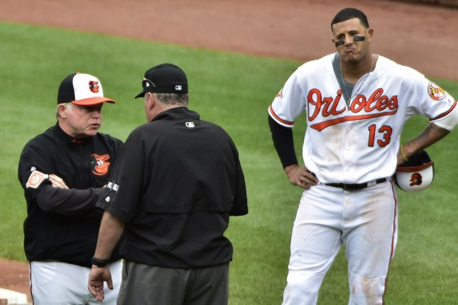 dee83218efc Baltimore Orioles manager Buck Showalter (L) talks to umpire Hunter  Wendelstedt (C) after Manny Machado (R) dodged a high pitch from Boston Red  Sox relief ...