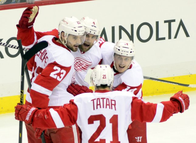Detroit Red Wings defenseman Brian Lashoff (23) joins his teammates in celebration. Lashoff signed a two-year deal with the team. Photo by Archie Carpenter/UPI