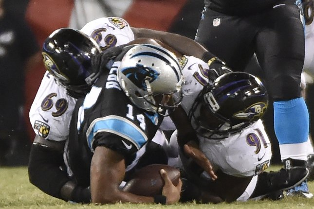 Carolina Panthers quarterback Joe Webb (14) is sacked by Baltimore Ravens defenders Willie Henry (69) and Matt Judon (91) during the second half of an NFL preseason game August 11 at M&T Bank Stadium in Baltimore. Judon was drafted in the fifth round by the Ravens, a fact he never expected because of his small size. File Photo by David Tulis/UPI