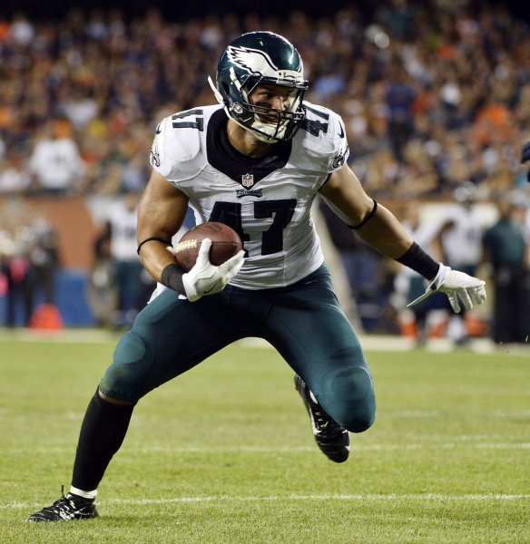 Philadelphia Eagles tight end Trey Burton looks to score a touchdown after a two-yard pass during during a game against the Chicago Bears in 2016. Burton reportedly will sign with the Bears in free agency. Photo by Brian Kersey/UPI