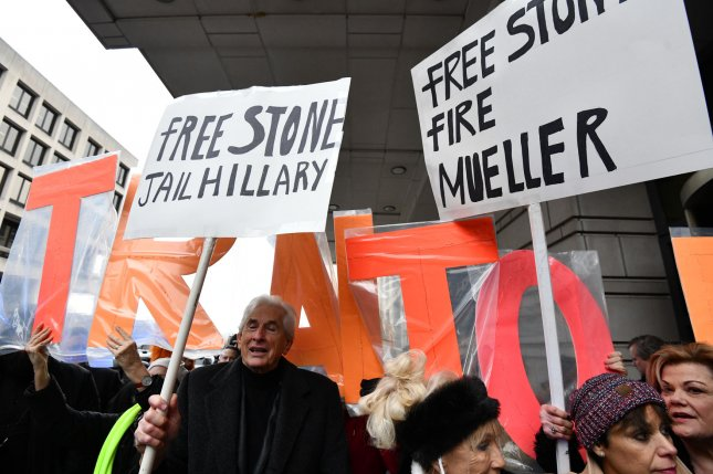 Supporters parade outside as former Trump adviser Roger Stone begins his hearings at a federal courtroom for his charges of witness tampering, false statements and obstruction of official proceeding in Washington, D.C., on Tuesday. Photo by Pat Benic/UPI