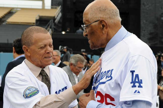Dodgers greats Maury Wills (L) and Don Newcombe chat before a ceremony at Dodger Stadium in Los Angeles in 2012. Newcombe died Tuesday at 92 years old. File Photo by Jayne Kamin-Oncea/UPI
