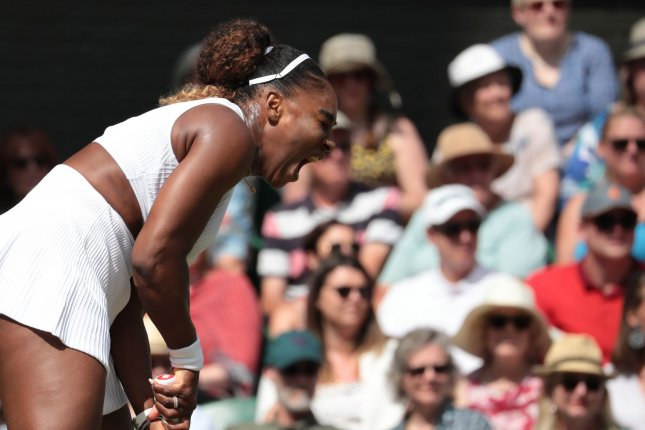 American Serena Williams can tie Margaret Court with a record 24th Grand Slam victory if she beats Simona Halep in the women's final at Wimbledon Saturday in London. Photo by Hugo Philpott/UPI