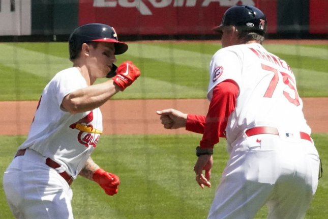 Cardinals outfielder Tyler O'Neill (L) slaps hands with third base coach Ron Warner Sunday after hitting a solo home run in the first inning against the Cincinnati Reds, at Busch Stadium in St. Louis, Mo. Photo by Bill Greenblatt/UPI