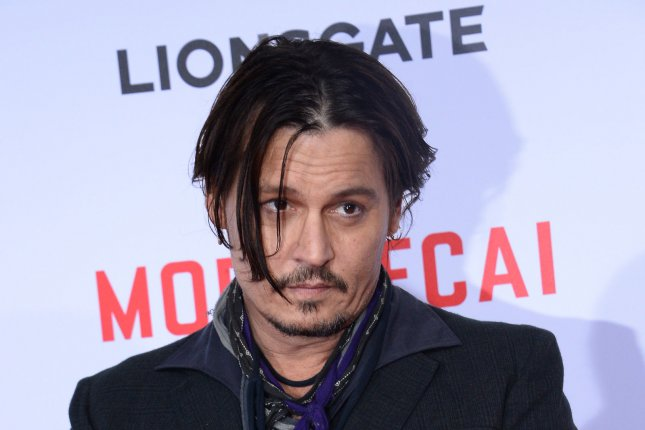 Johnny Depp brought his two pups Pistol and Boo into Australia via private jet without reporting them. Australian law states that animals brought into the country must be placed under a 10-day quarantine. Photo by Jim Ruymen/UPI