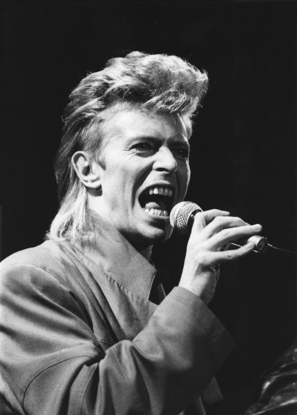 """Veteran British rocker David Bowie is bursting with energy as he opens the first of two concerts at Giants Stadium late August 2, 1987, during his """"Glass Spider"""" tour in East Rutherford, N.J. Bowie died Sunday of cancer. File photo by Roth/UPI"""