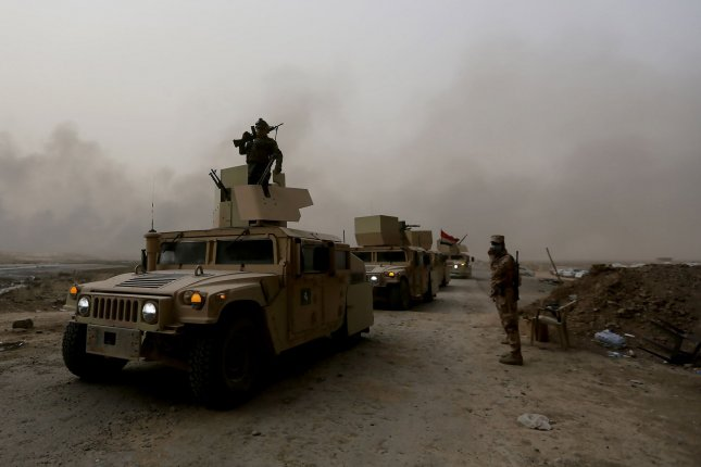 A top commander from Britain has called for patience from the international community in regards to the offensive against the Islamic State in Iraq, where a U.S. official said the militant group has lost about 55 percent of territory it held at its peak in 2014. In this image, Iraqi security forces move during fighting with the Islamic State near Mosul on November 1. Photo by Murat Bay/UPI