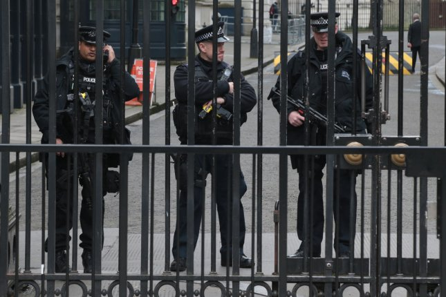 Armed Metropolitan Police remain vigilant on Thursday while roads remain closed and cordoned off around Westminster Palace after Wednesday's attack on Westminster Bridge and the Houses of Parliament where four people are known to have died. Met Police said authorities have carried out two more arrests, raising the total of those arrested in response to the incident to 10 -- one of whom was released on bail. Photo by Hugo Philpott/UPI