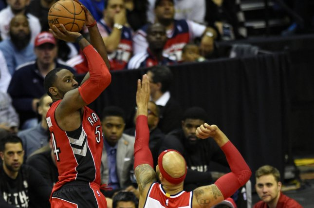 Toronto Raptors forward Patrick Patterson (54) scores against Washington Wizards forward Drew Gooden (90) in the first half. File photo by Mark Goldman/UPI