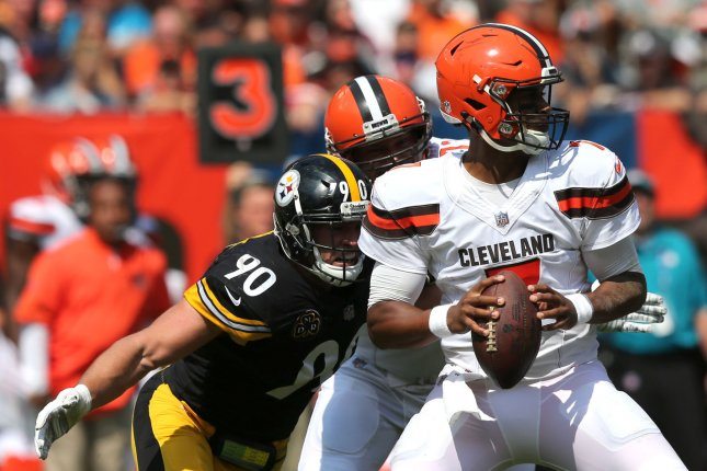 Cleveland Browns quarterback DeShone Kizer looks to pass as Pittsburgh Steelers defender T.J. Watt prepares to hit him during the first quarter on September 10 at First Energy Stadium in Cleveland, Ohio. Photo by Aaron Josefczyk/UPI