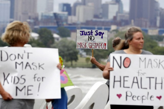 Protesters rally against a mandatory statewide mask order in Ohio, at Edgewater Park in Cleveland, Ohio, on Saturday. Photo by Aaron Josefczyk/UPI
