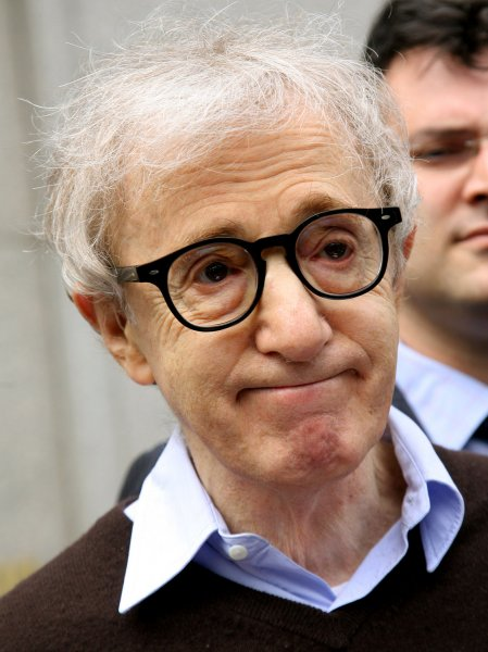 Movie director Woody Allen leaves Federal Court after reaching a settlement with American Apparel for illegally using an image from one of his films in billboard ads on May 18, 2009 in New York. (UPI Photo/Monika Graff)