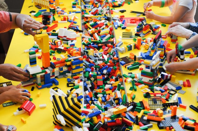 Children and adults play with LEGOs at an exhibition. (UPI/Alexis C. Glenn)