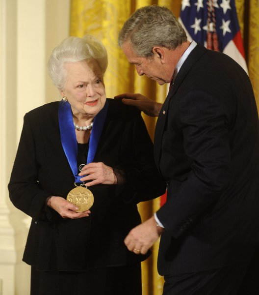 President George W. Bush (R) presents actress Olivia De Havilland with the 2008 National Medals of Arts during a ceremony in the East Room at the White House on November 17, 2008. De Havilland celebrates her 100th birthday on Friday. File Photo by Kevin Dietsch/UPI