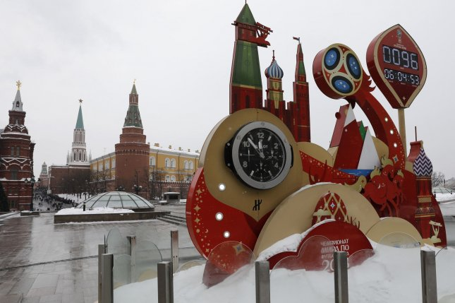 A symbolic clock shows the days remaining until the 2018 FIFA World Cup Russia near the Kremlin in Moscow on March 10. File Photo by Yuri Gripas/UPI