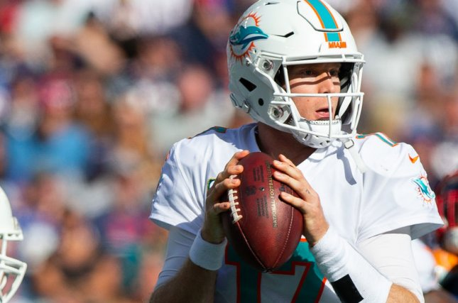 Miami Dolphins quarterback Ryan Tannehill (17) drops back ro pass during a game against the New England Patriots at Gillette Stadium in Foxborough, Massachusetts on September 30, 2018. Photo by Matthew Healey/UPI