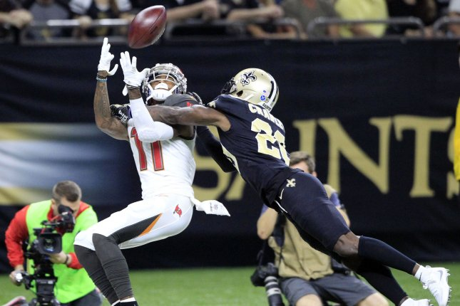New Orleans Saints cornerback Ken Crawley (20) knocks the ball away from Tampa Bay Buccaneers wide receiver DeSean Jackson (11). File photo by AJ Sisco/UPI