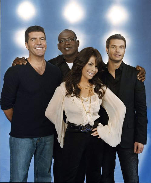 Judges Simon Cowell, Randy Jackson, Paula Abdul and host Ryan Seacrest (L-R) on the American Idol television show are pictured in this publicity photo released by Fox television. Idol returned for its sixth season in a special two-night, four-hour season premiere Tuesday, January16, 2007. EDITORIAL USE ONLY (UPI Photo/Fox/HO)