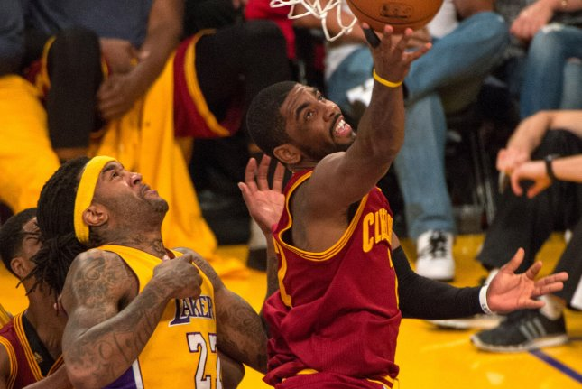 Cleveland Cavalier guard Kyrie Irving (2) scores past Los Angeles Lakers center Jordan Hill (27) during the first half of their NBA game at Staples Center in Los Angeles, January 15, 2015. The Cavaliers defeated the Lakers 109-102. UPI/Jon SooHoo