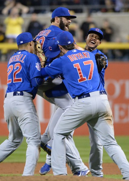 Chicago Cubs mob pitcher Jake Arrieta after defeating the Pittsburgh Pirates 4-0 in the National League Wild Card at PNC Park in Pittsburgh on October 7, 2015. Arrieta pitched a four hit shutout to defeat the Pirates and move on to the NLDS. Photo by Pat Benic/UPI