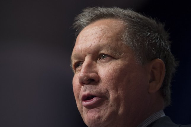 Former New Hampshire Rep. Chuck Douglas endorsed Ohio Gov. John Kasich's bid for the White House Tuesday. Photo by Molly Riley/UPI