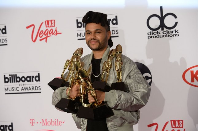 Singer The Weeknd appears backstage with his eight awards during the annual Billboard Music Awards on May 22, 2016. Photo by Jim Ruymen/UPI